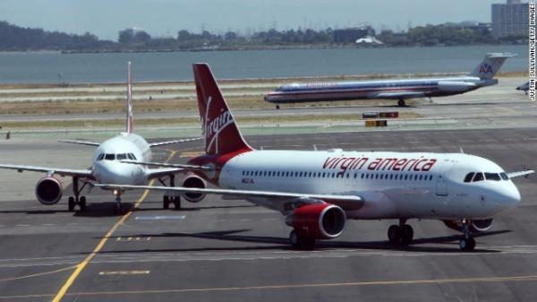 """美国资讯网综合报道 美国年度航空公司评级报告出炉,维珍美国航空公司连续第二年获得第一。   根据最新公布的关于美国15个最大的航空公司的调查,总部位于加州的维珍美国(Virgin America)航空在这项包括准点率、乘客投诉、行李丢失等项目的关于航空公司总体质量的评比中排名第一。   据《洛杉矶时报报导》,这项被称为""""航空公司质量评分""""的报告也发现美国航空公司2013年的整体表现优于之前的年份。这份报告的数据来自于美国交通部的数据,并由安柏瑞德(Embry-Riddle)航空"""